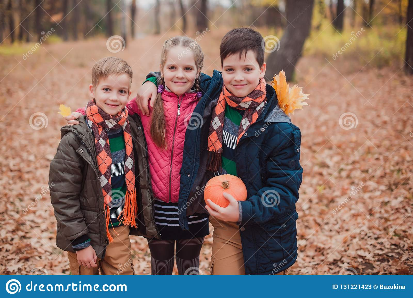 Two brothers and one sister, three children in the forest.