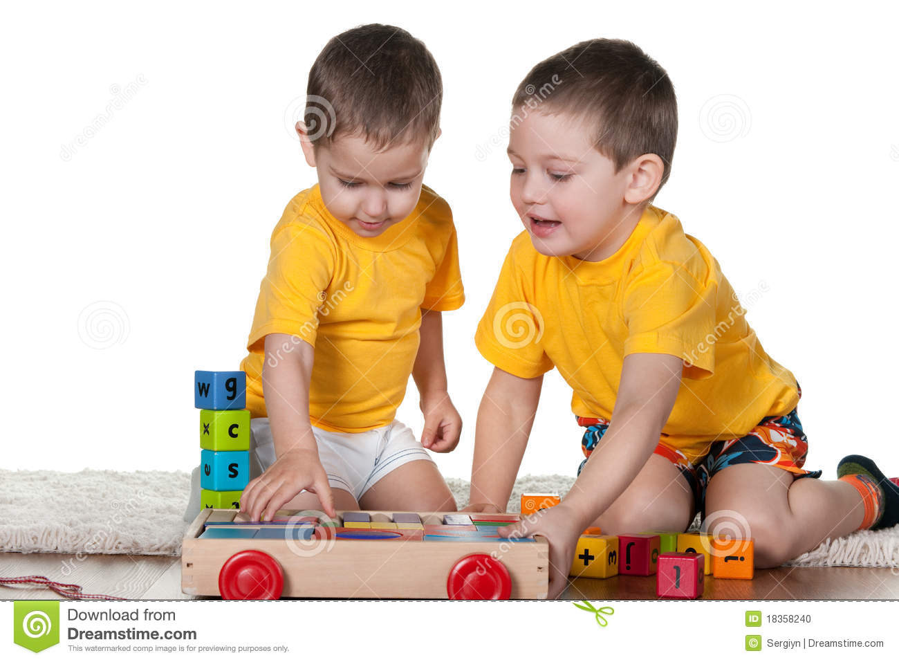 Two brothers playing blocks stock photo image 18358240 for Www dreamhome com
