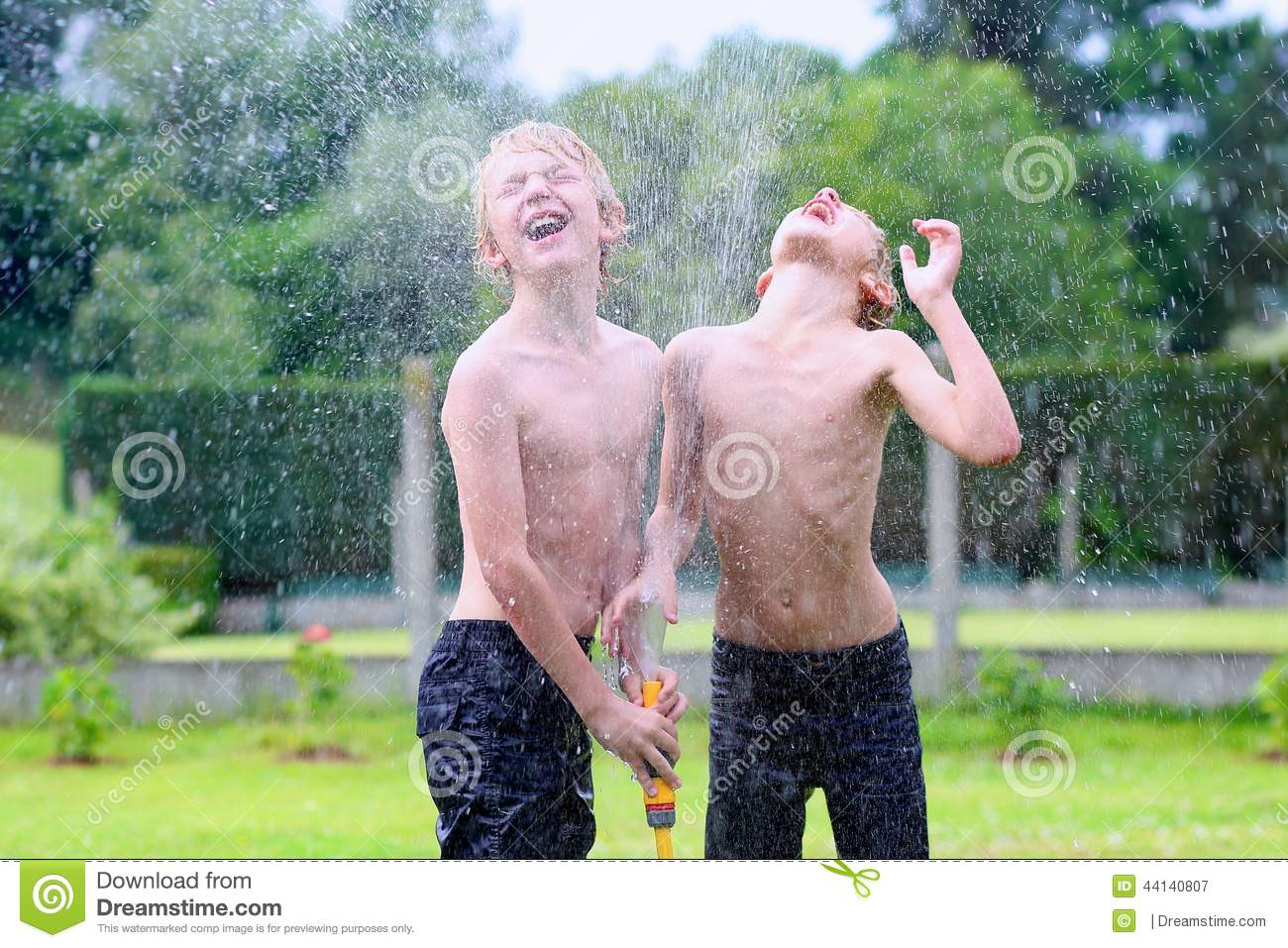 Download Two Brothers Playing With Water Hose In The Garden Stock Image - Image of playful, lawn: 44140807