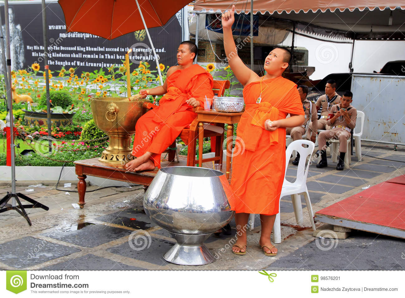 Two Buddhist monks are working near to temple.