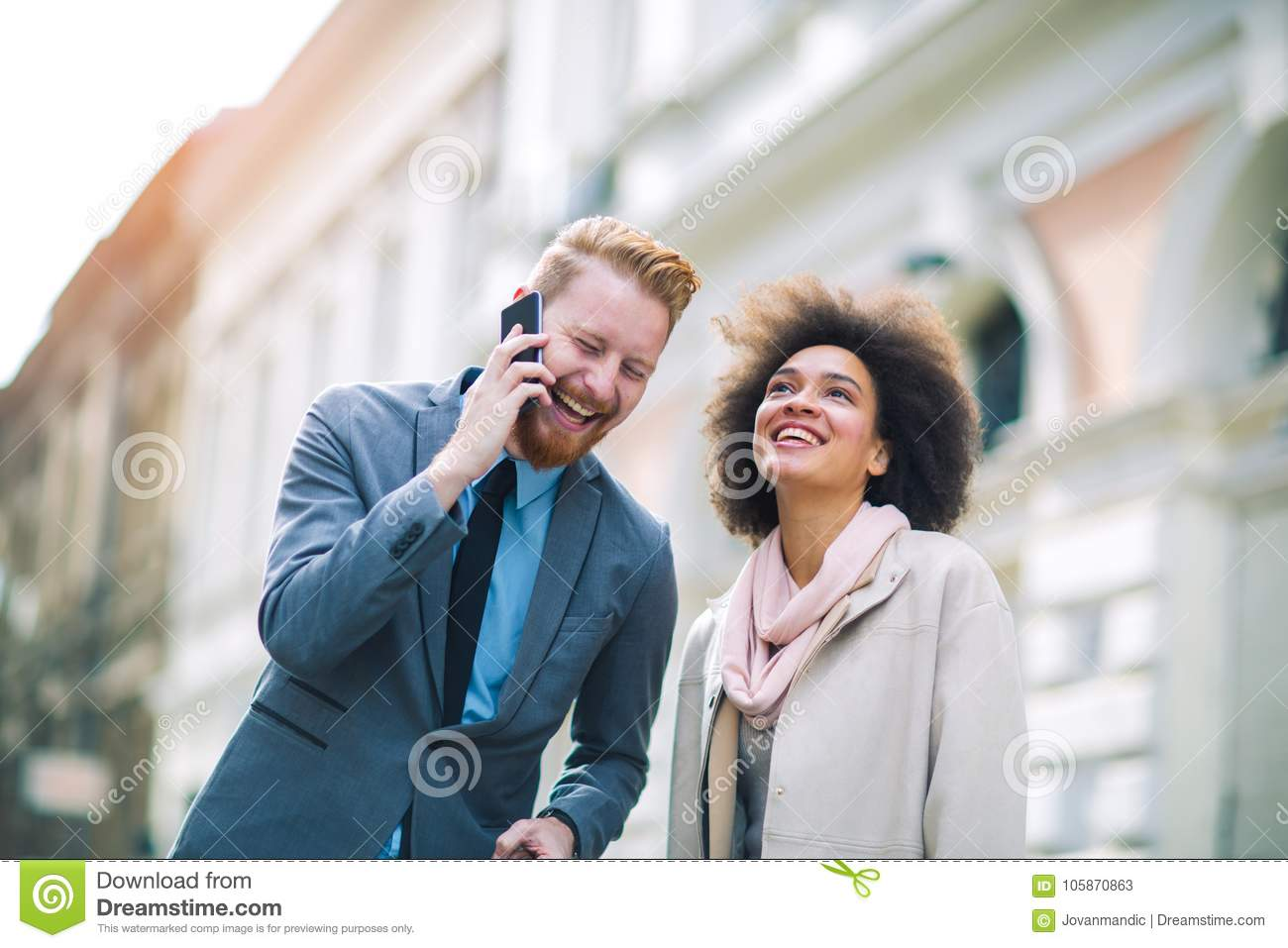Two business people in an informal conversation