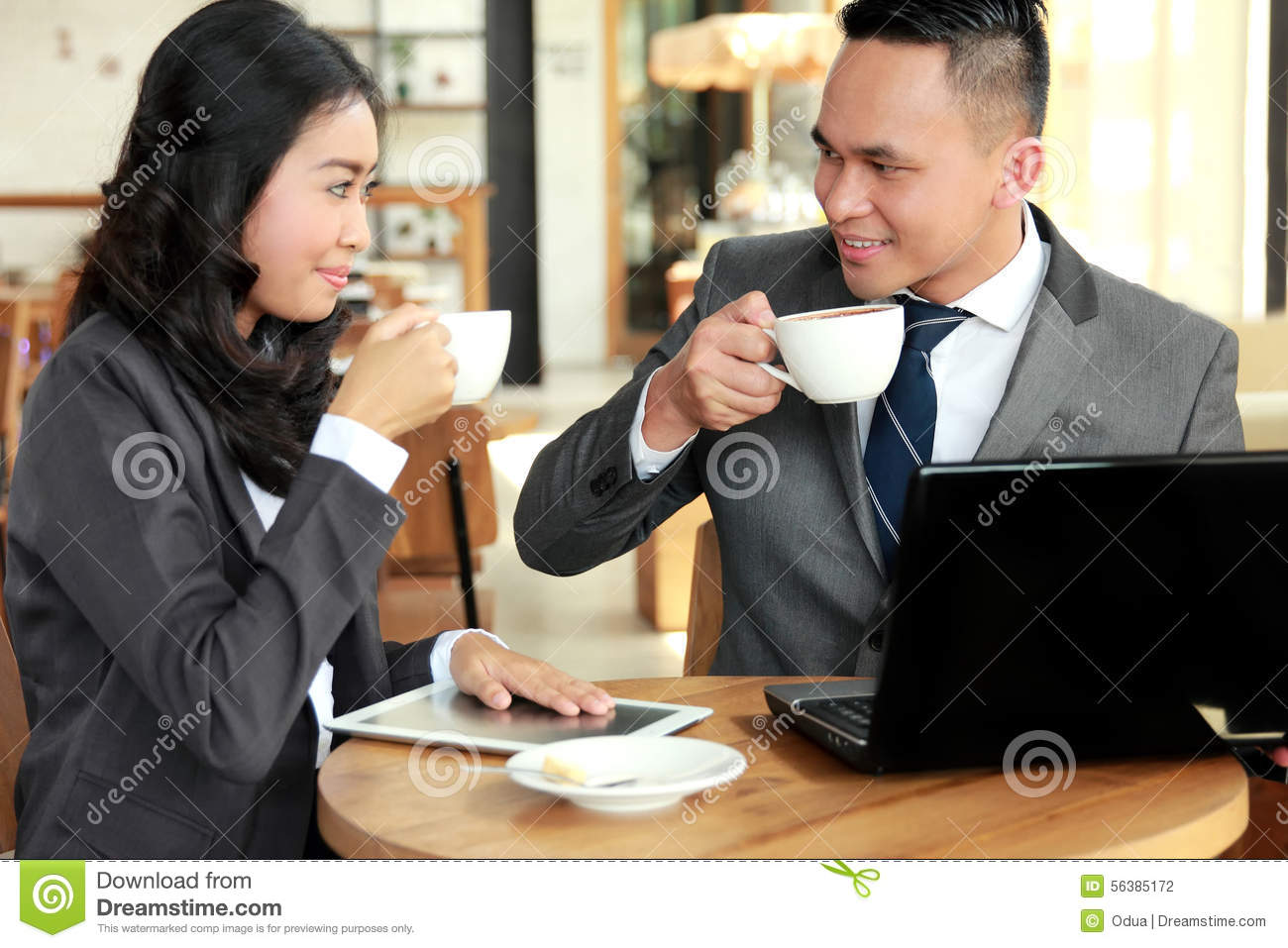 Two Business People Meeting During Coffee Break At Coffee ...