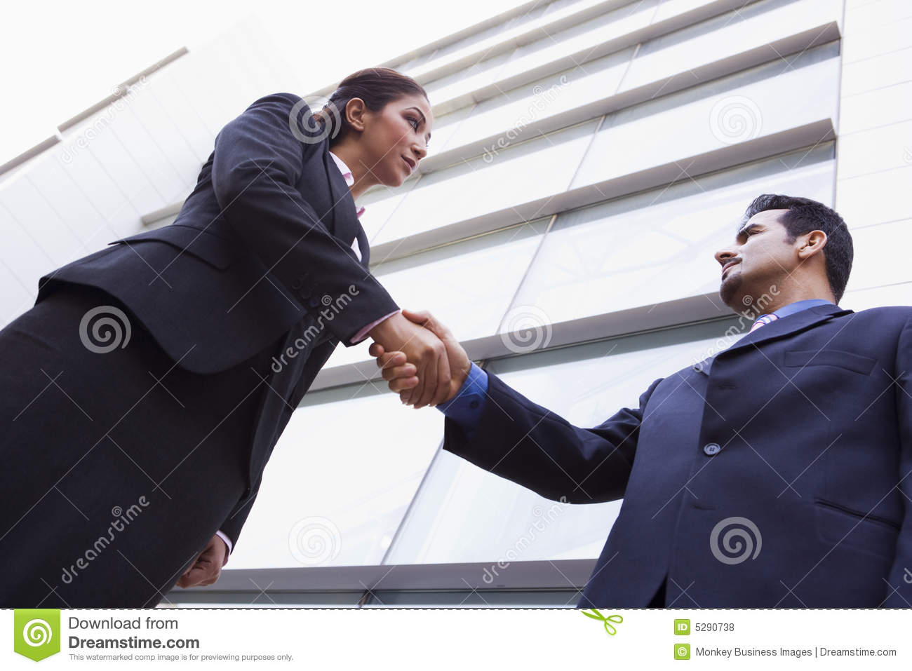 ... Free Stock Photos: Two business people shaking hands outside office