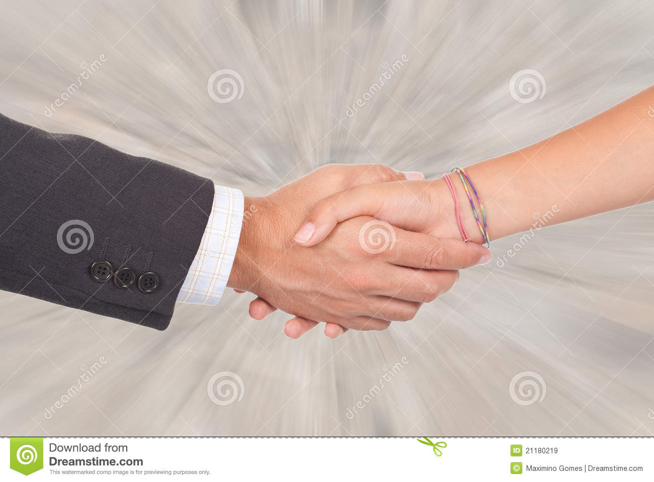 Two business person shaking hands on a deal
