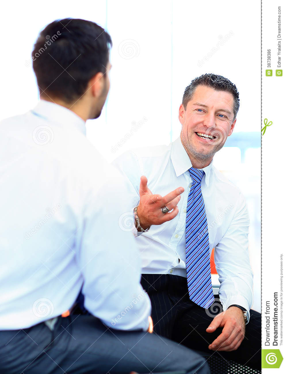 Two Businessmen Discus...