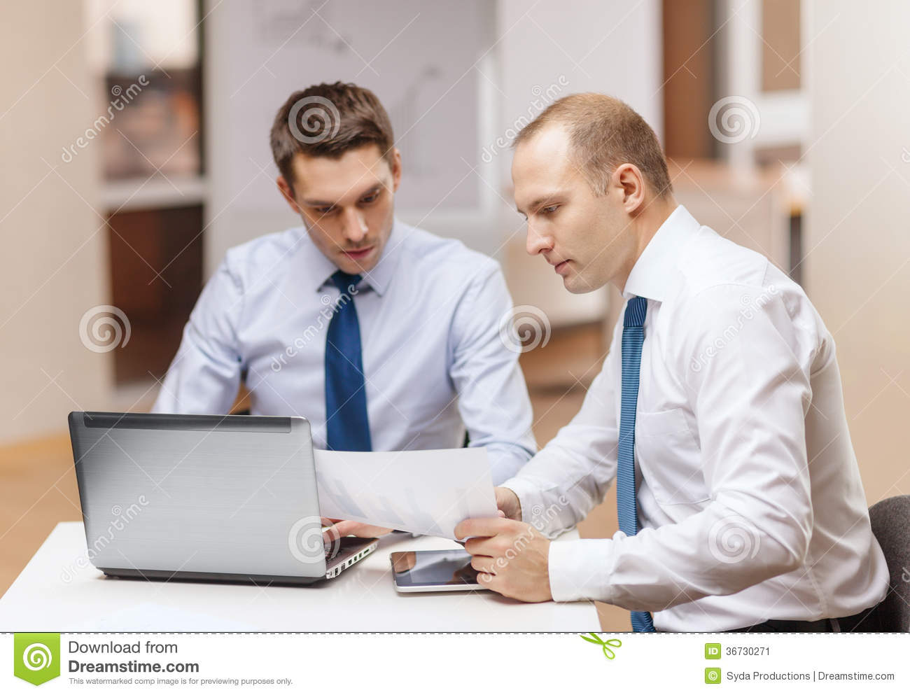 Two Businessmen Workin...