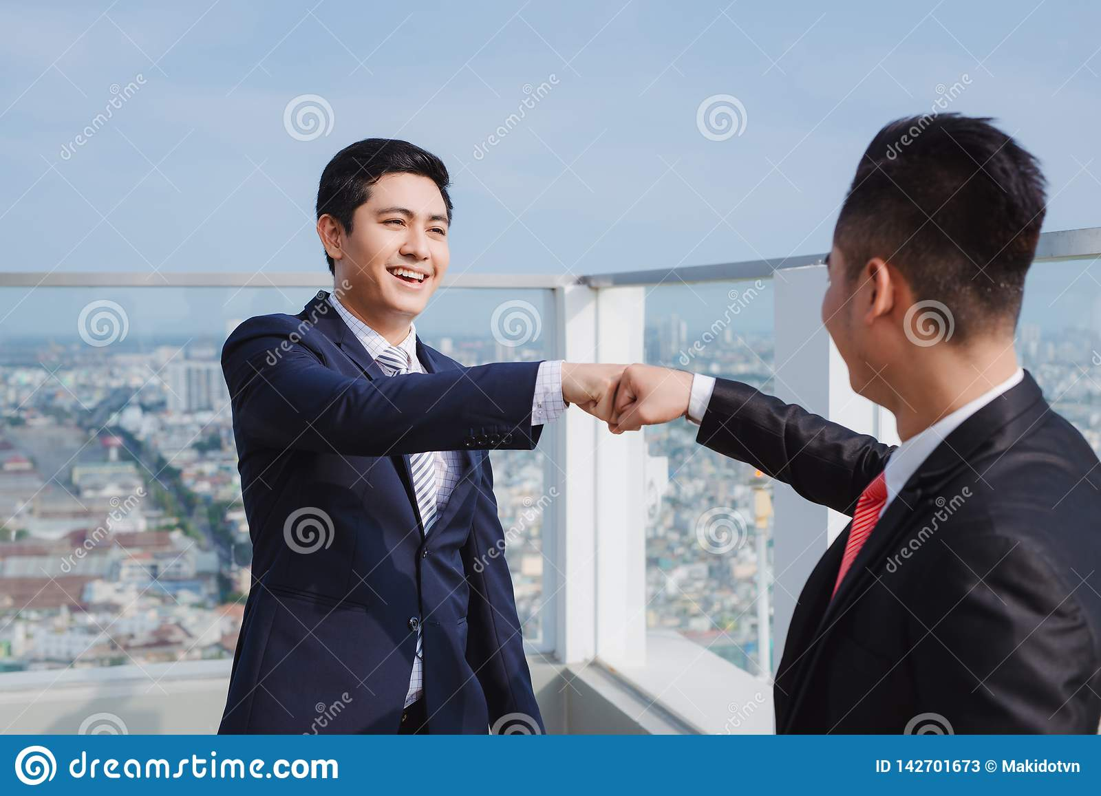 Two businessmen,two businessmen looking at the tablet and discussing the project and the economic weight.. Concept of: team,