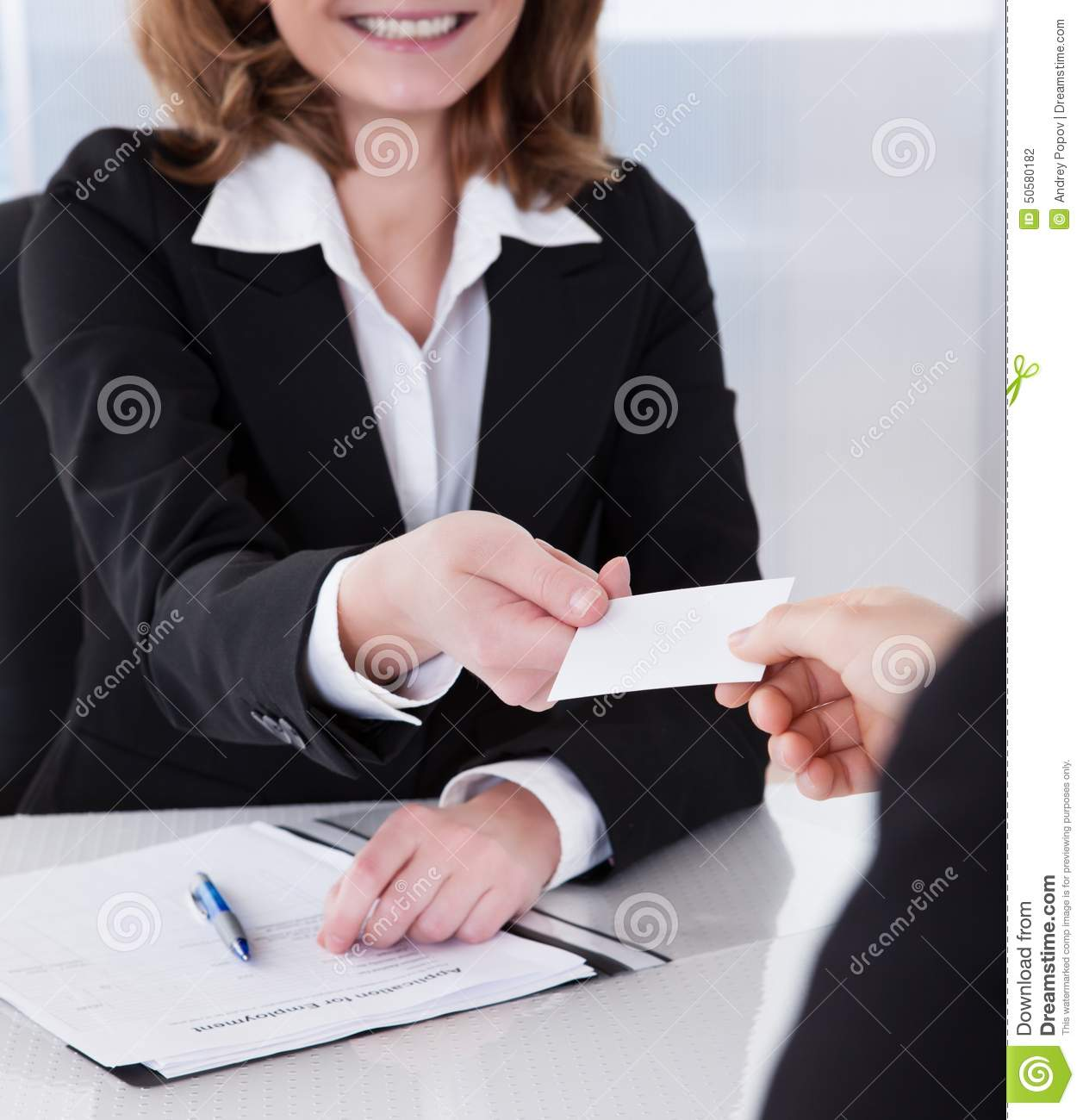 two businesspeople exchanging visiting card stock photo