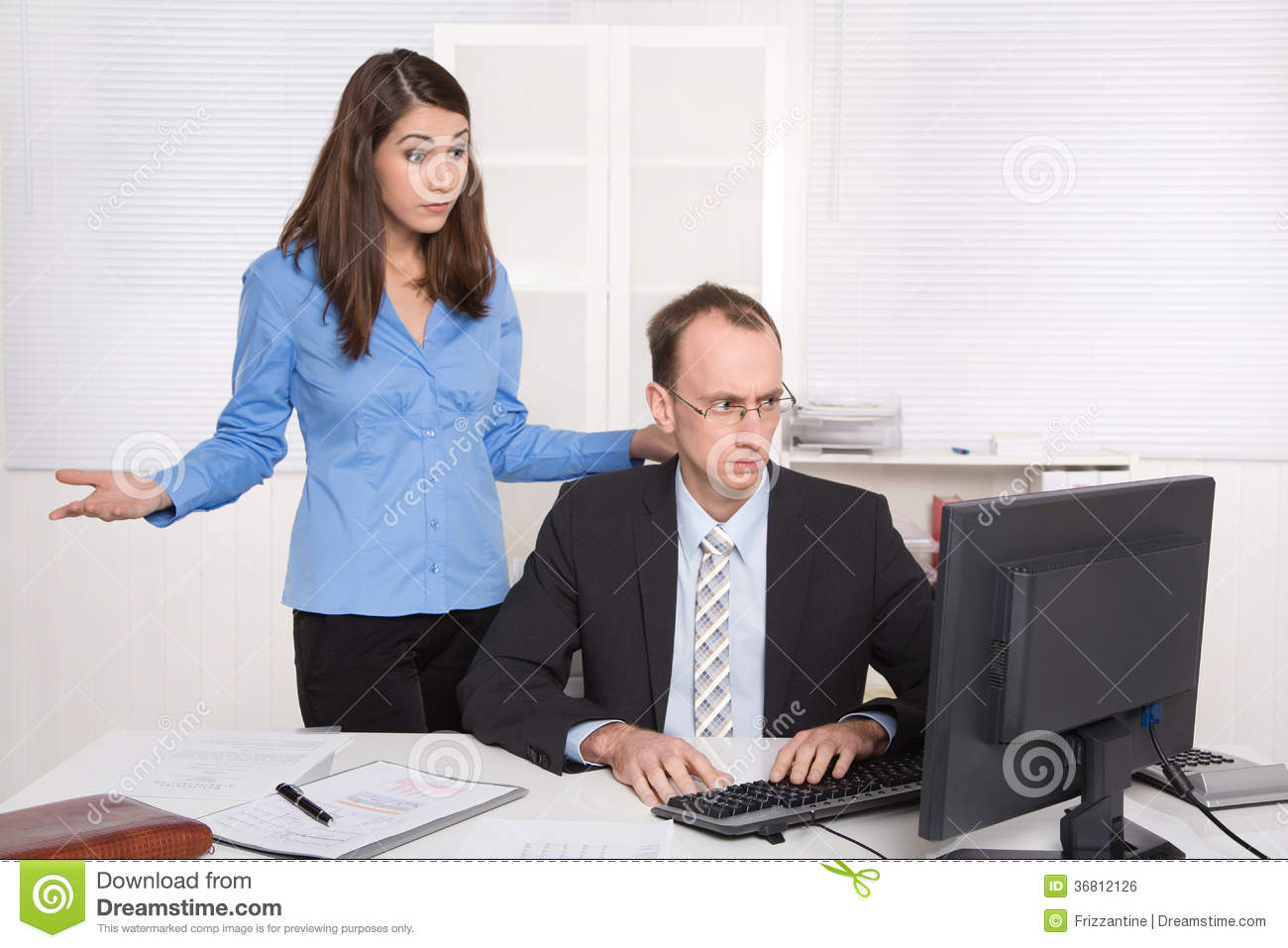 Two businesspeople in the office - discussion or bullying at work