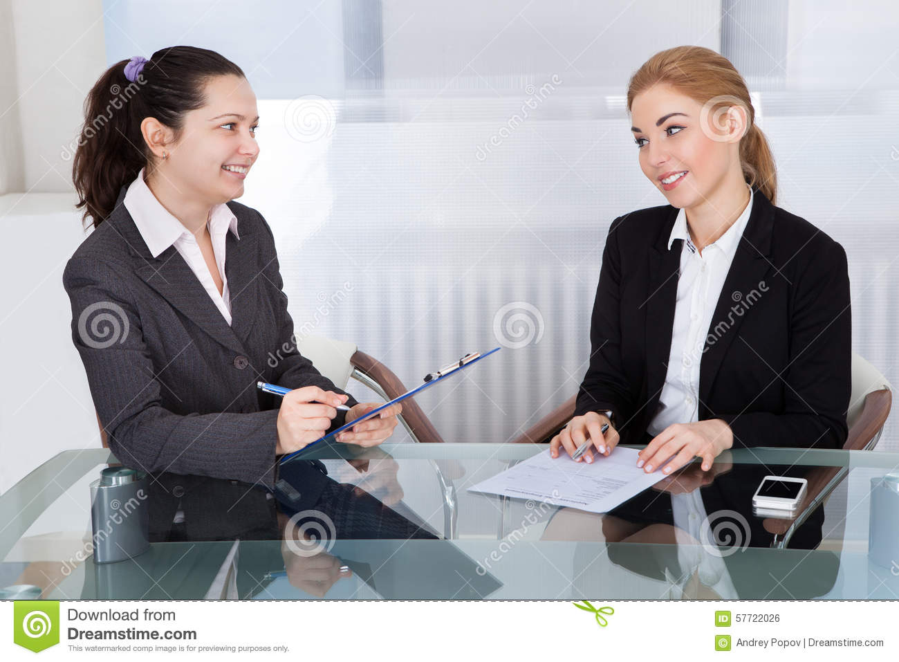 two businesspeople talking with each other stock photo image of