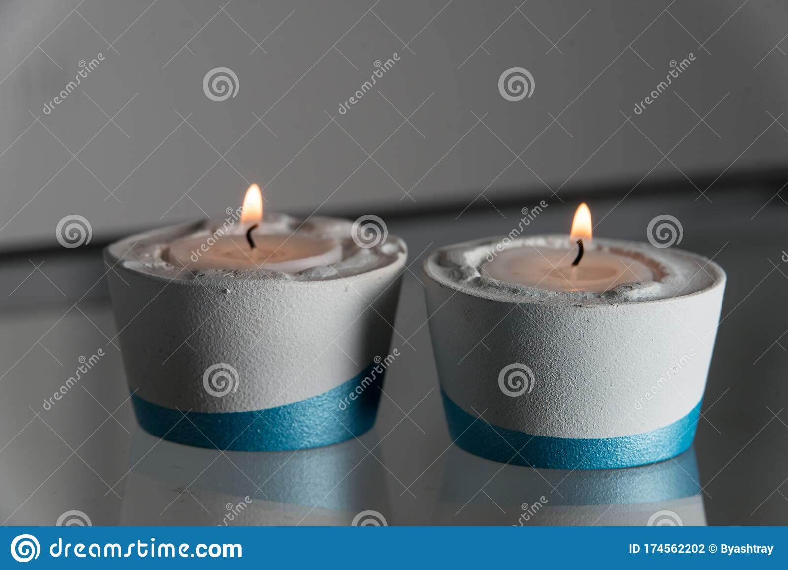 Two Candles In White And Blue Concrete Candle Holders Stock Photo Image Of Relax Decoration 174562202