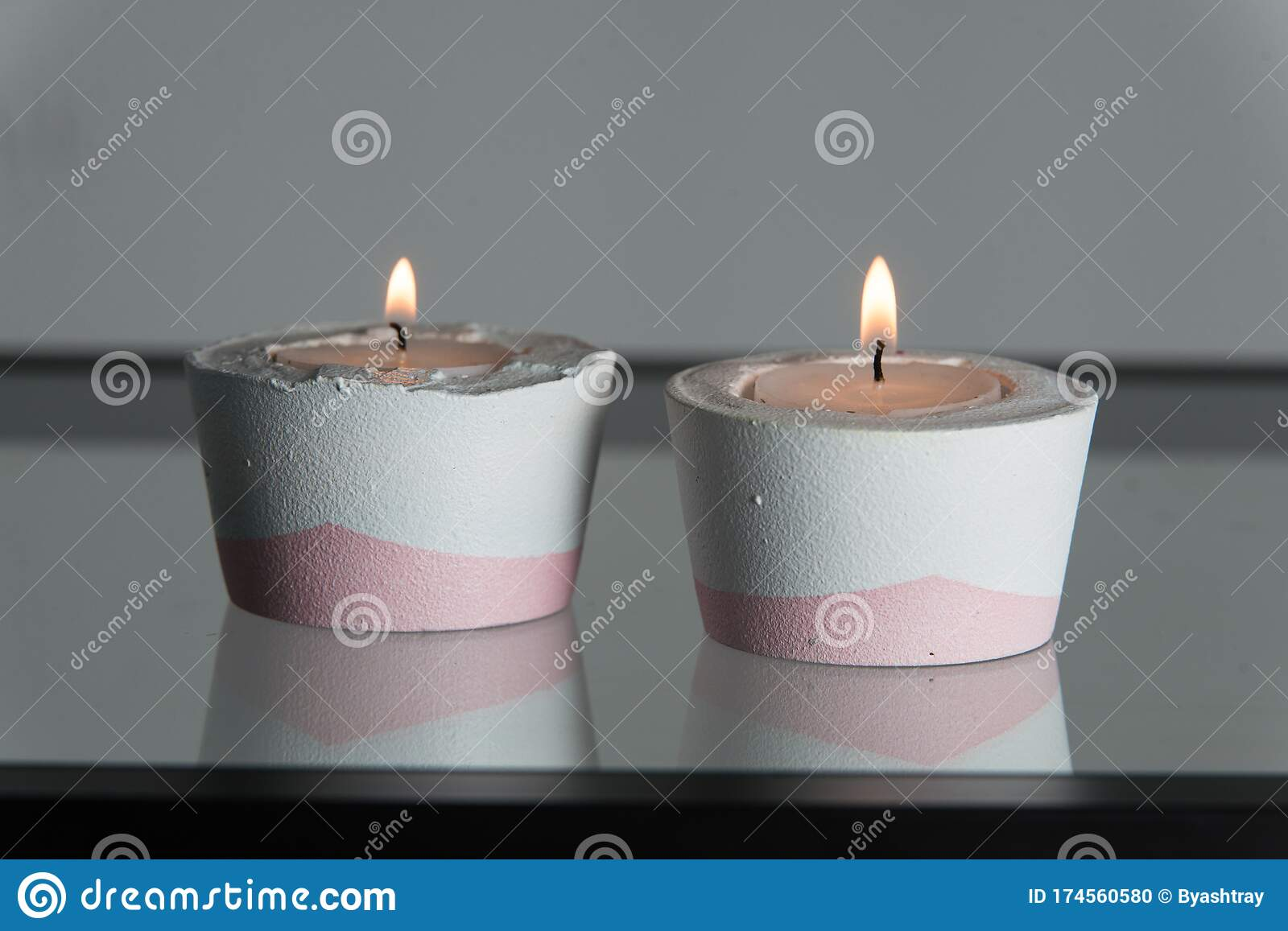 Two Candles In White And Pink Concrete Candle Holders Stock Photo Image Of Flame Cement 174560580