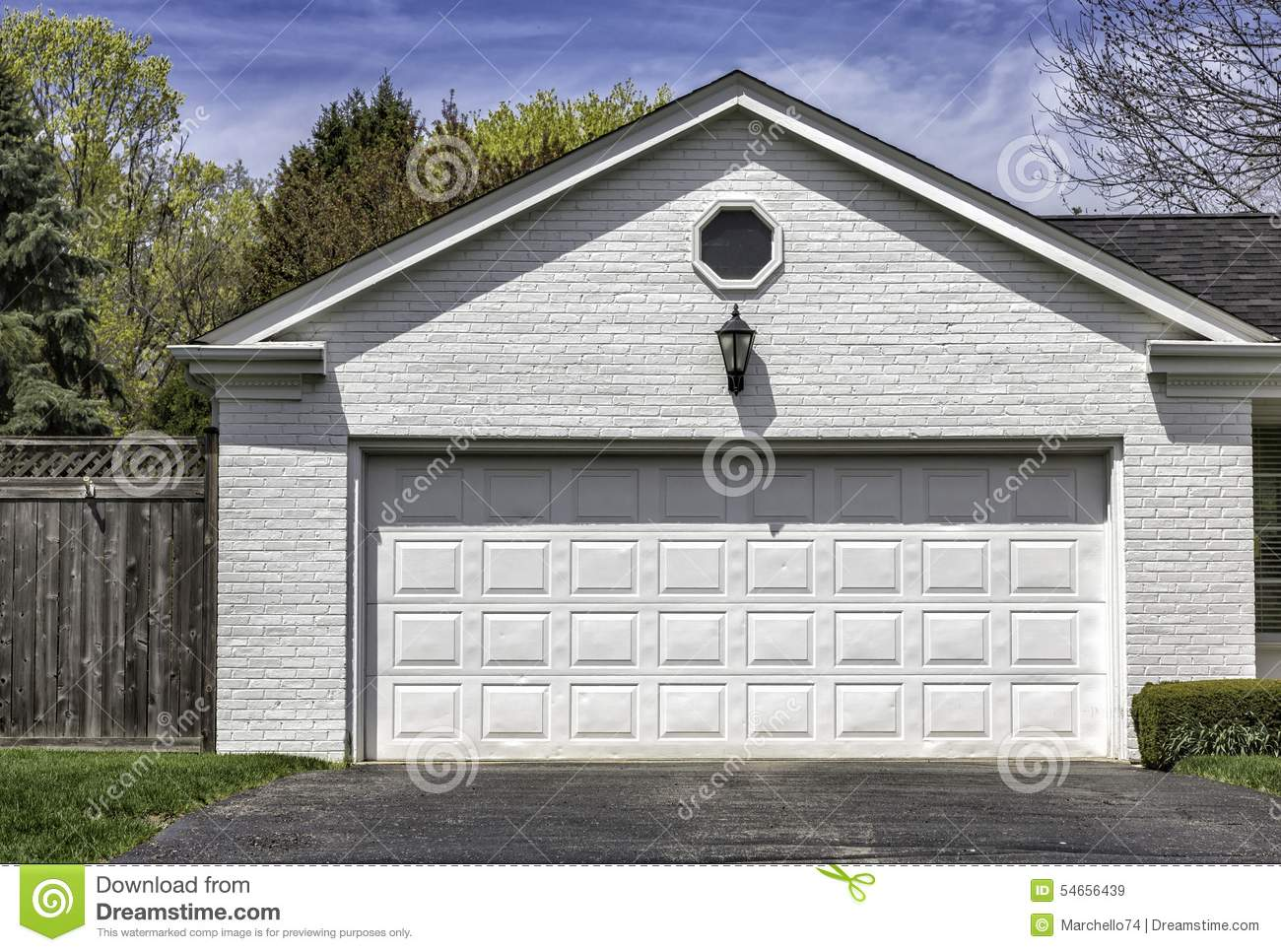 Two car white brick garage stock image image of carpentry for Brick garages prices