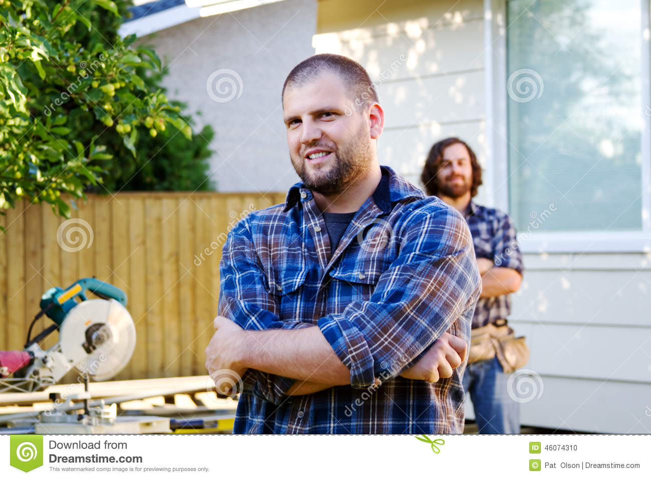 Two carpenters standing by deck