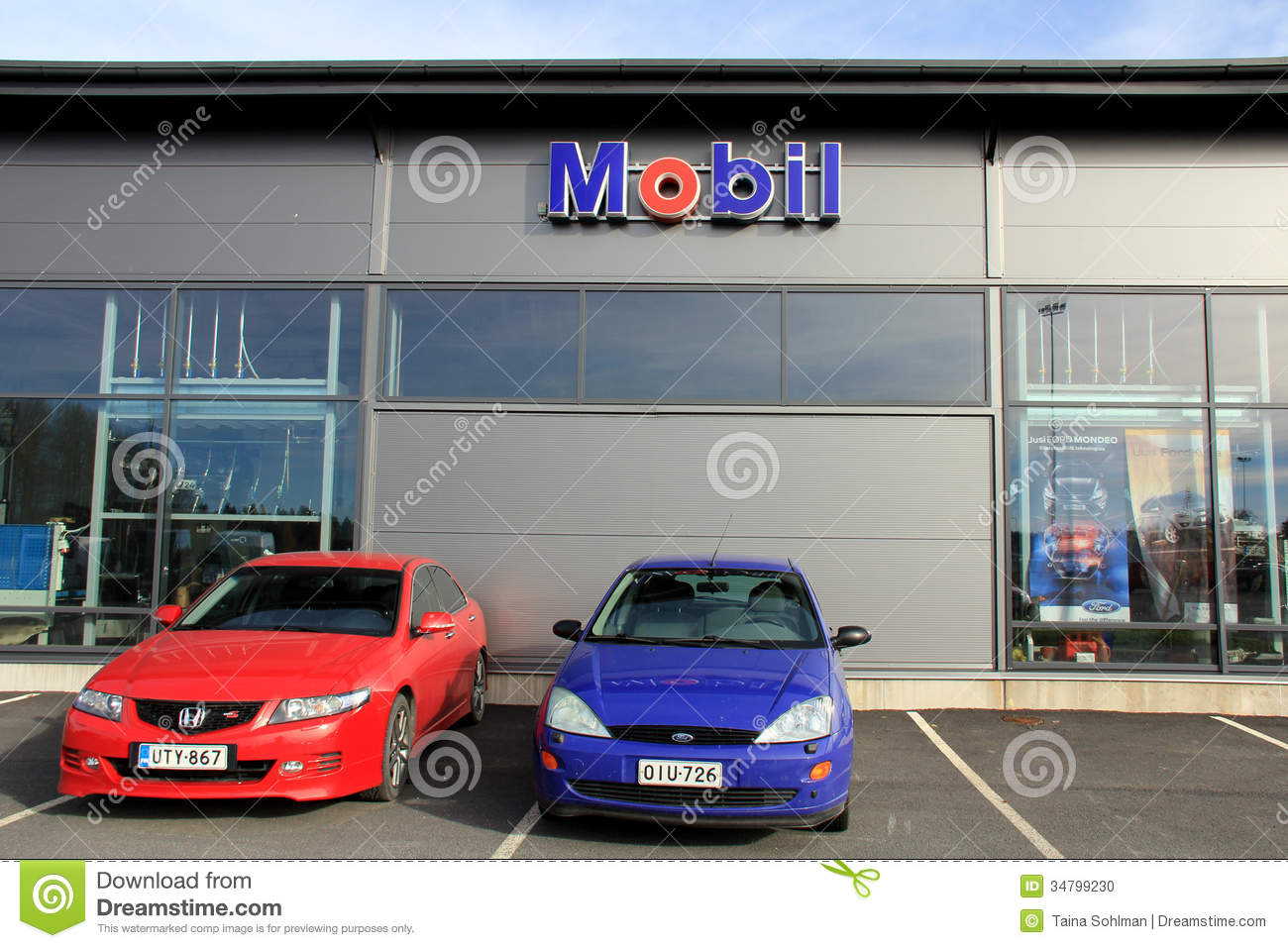 Two Cars In Front Of A Shop With Mobil Sign Editorial Image - Car sign and name