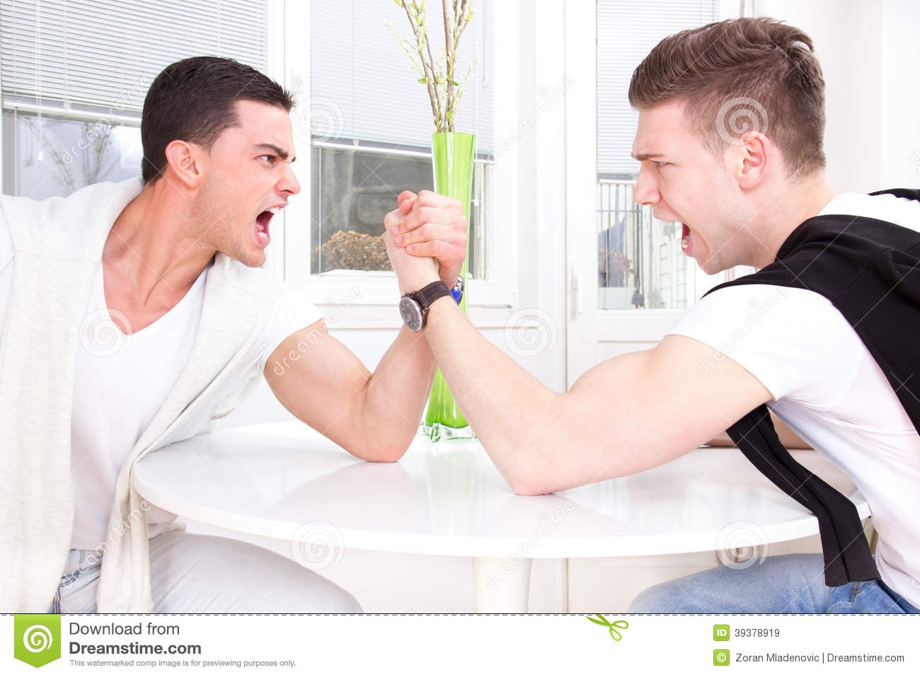 Two casual men arm wrestling