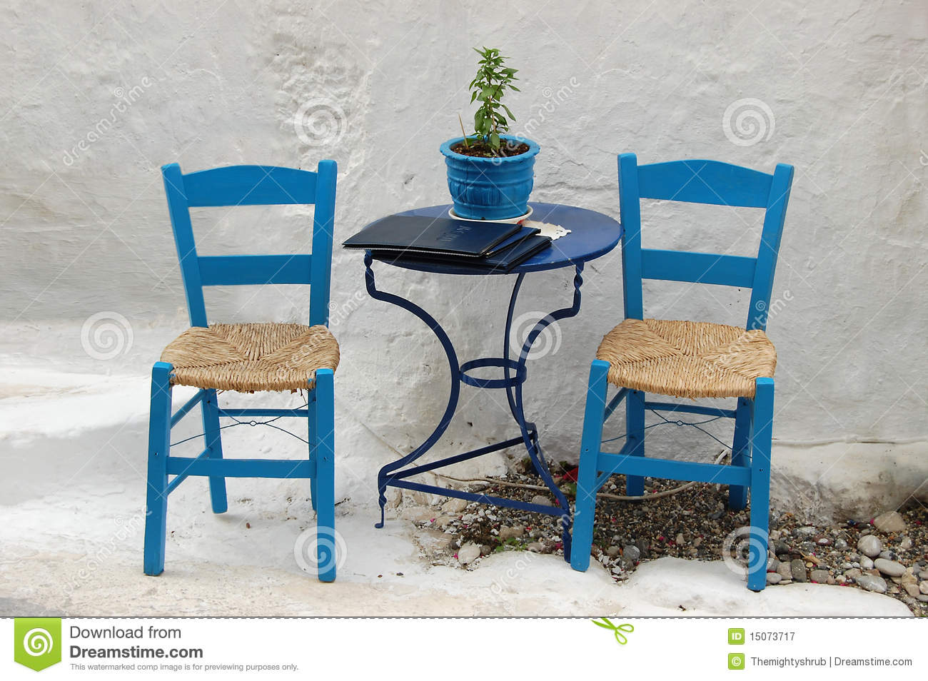 Two chairs outside a greek restaurant stock image