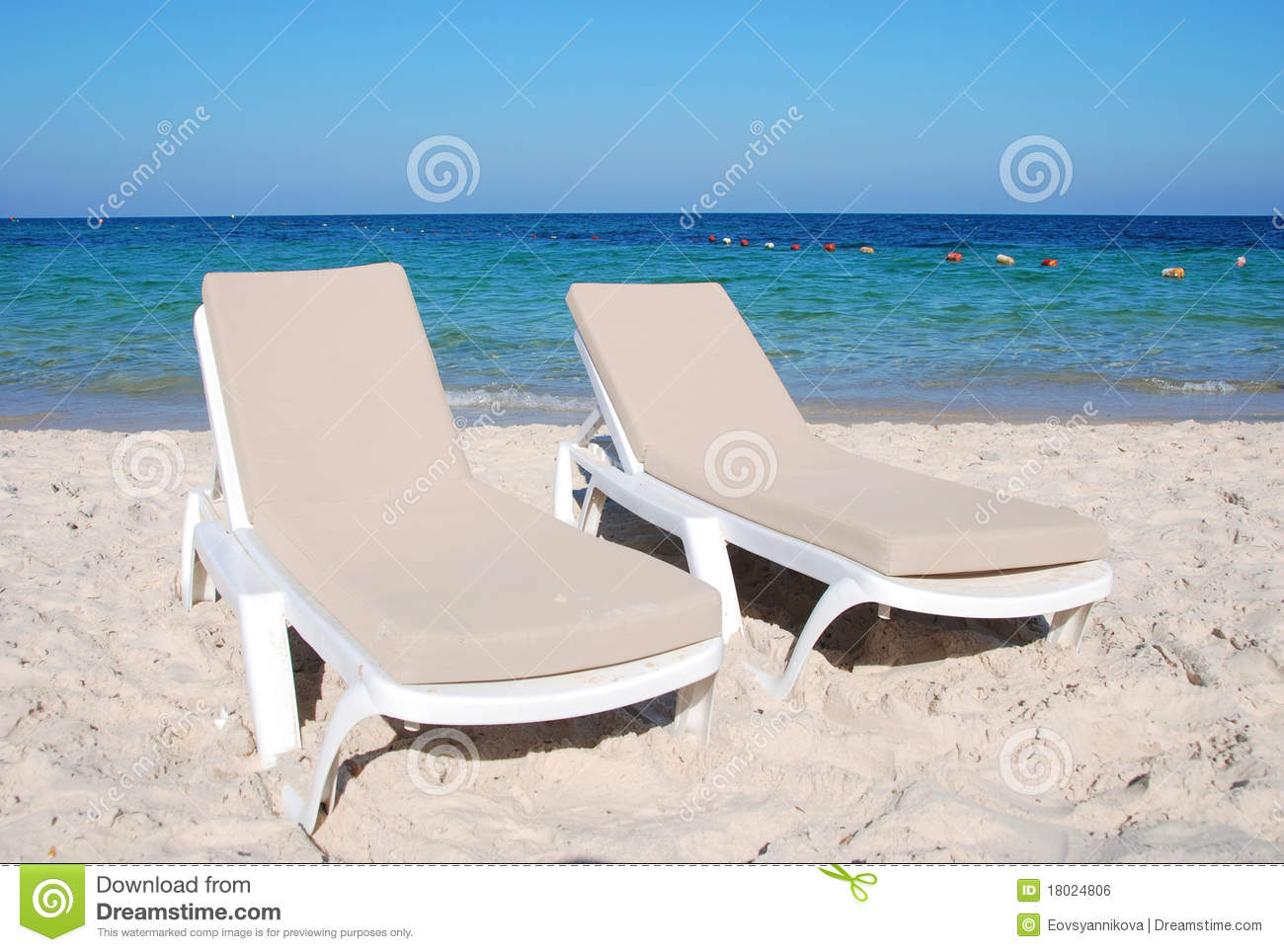 Two chaise longues on the beach royalty free stock image for Beach chaise longue
