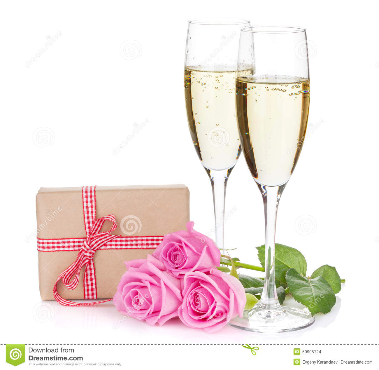 Two Champagne Glasses Gift Box And Pink Rose Flowers Stock Photo