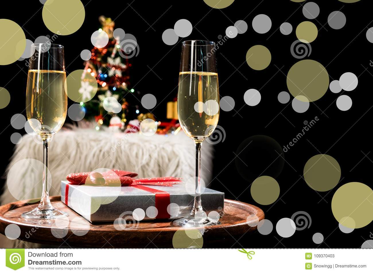 Two champagne glasses ready to bring in the New Year and christmas party background.