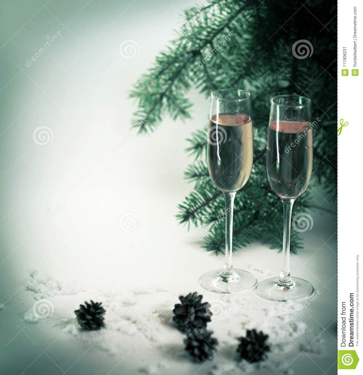 Two champagne glasses ready to bring of the New Year