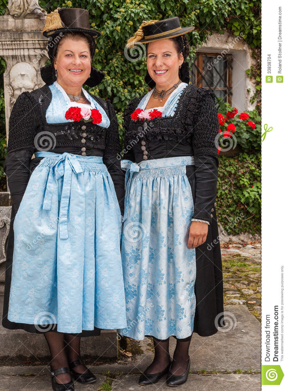 Two Charming Ladies In Traditional Dirndls Stock Photo