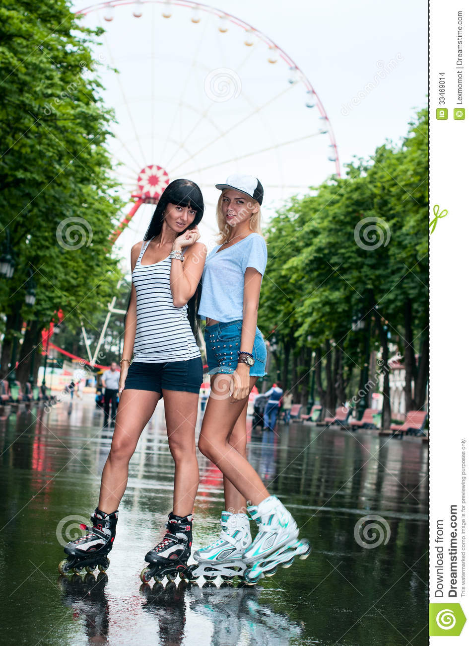 two cheerful girls rollerblading stock images   image