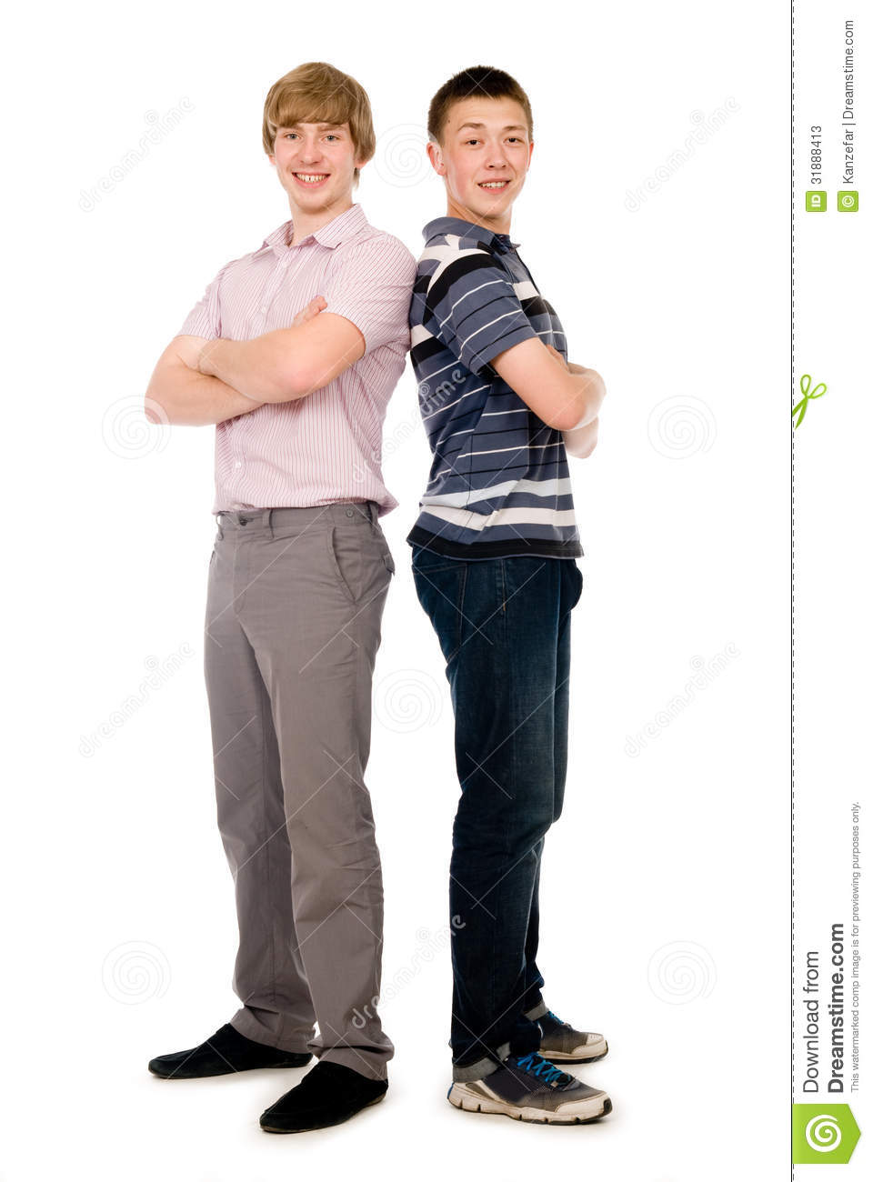 two cheerful young students standing back to back stock