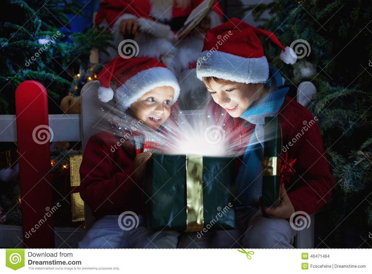 Two children opening Christmas gift