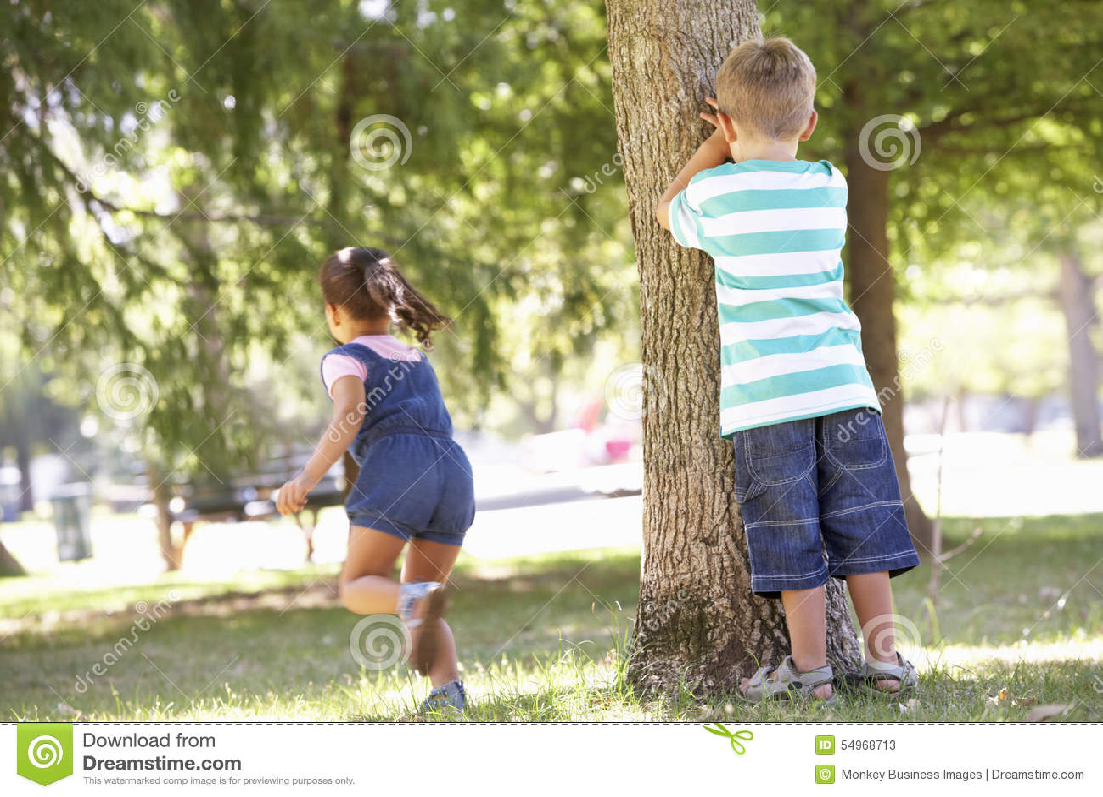Hide Seek Kids: Two Children Playing Hide And Seek In Park Stock Photo