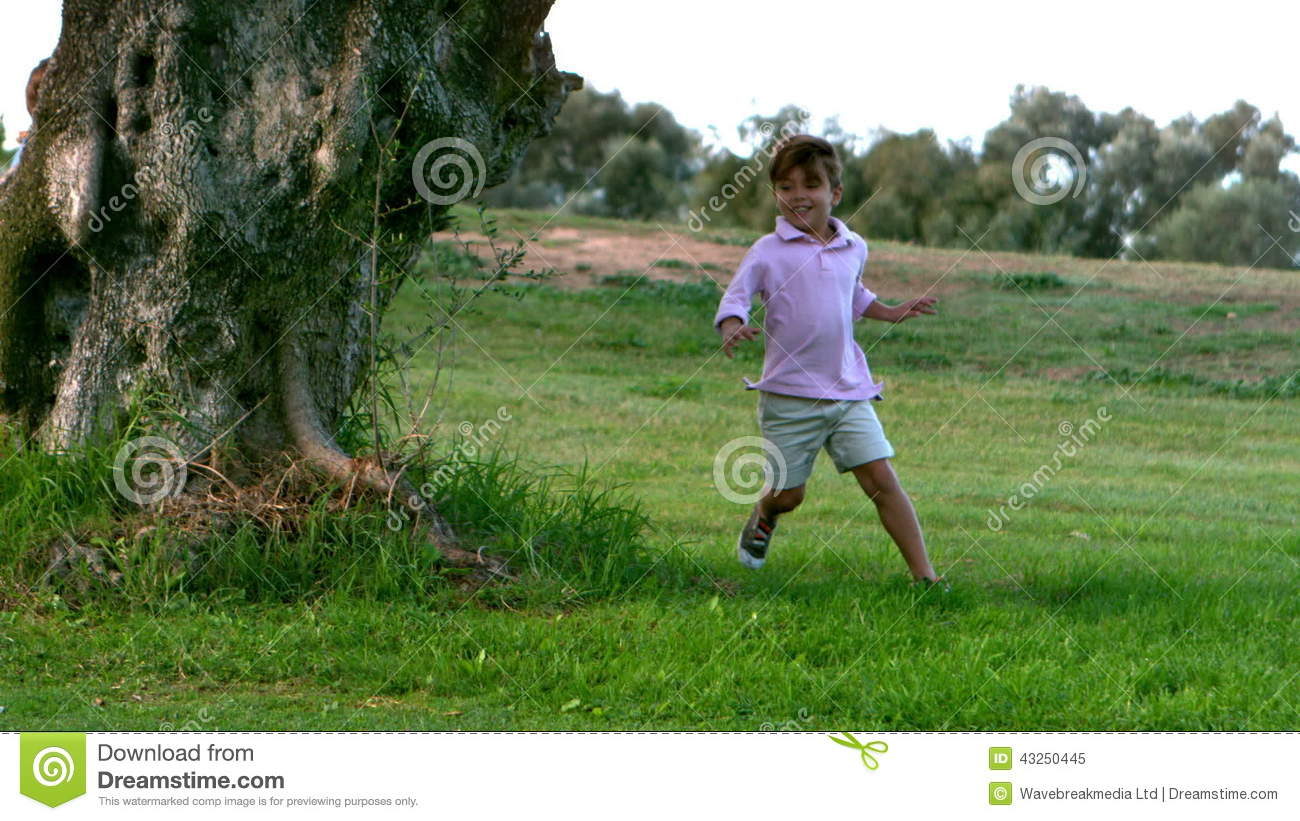 Two Children Running Around A Tree Playing Chasing Stock Video - Video of  enjoying, long: 43250445