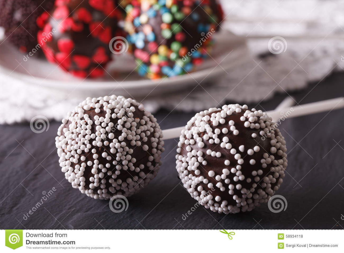 Two Chocolate Cake Pops With White Candy Sprinkles Close ...