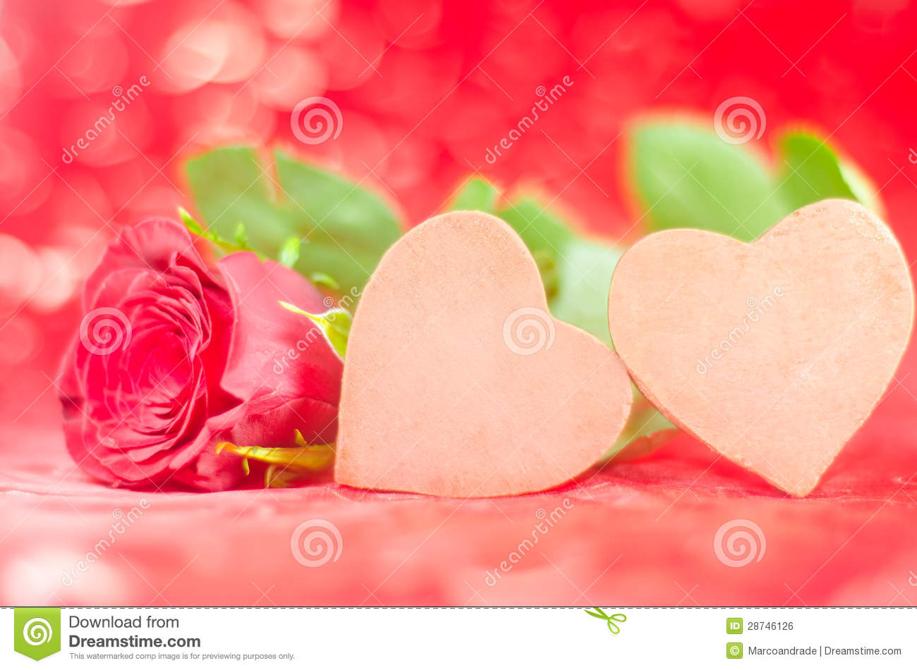 Two Chocolate Hearts With Rose In Lovely Background Stock Photo