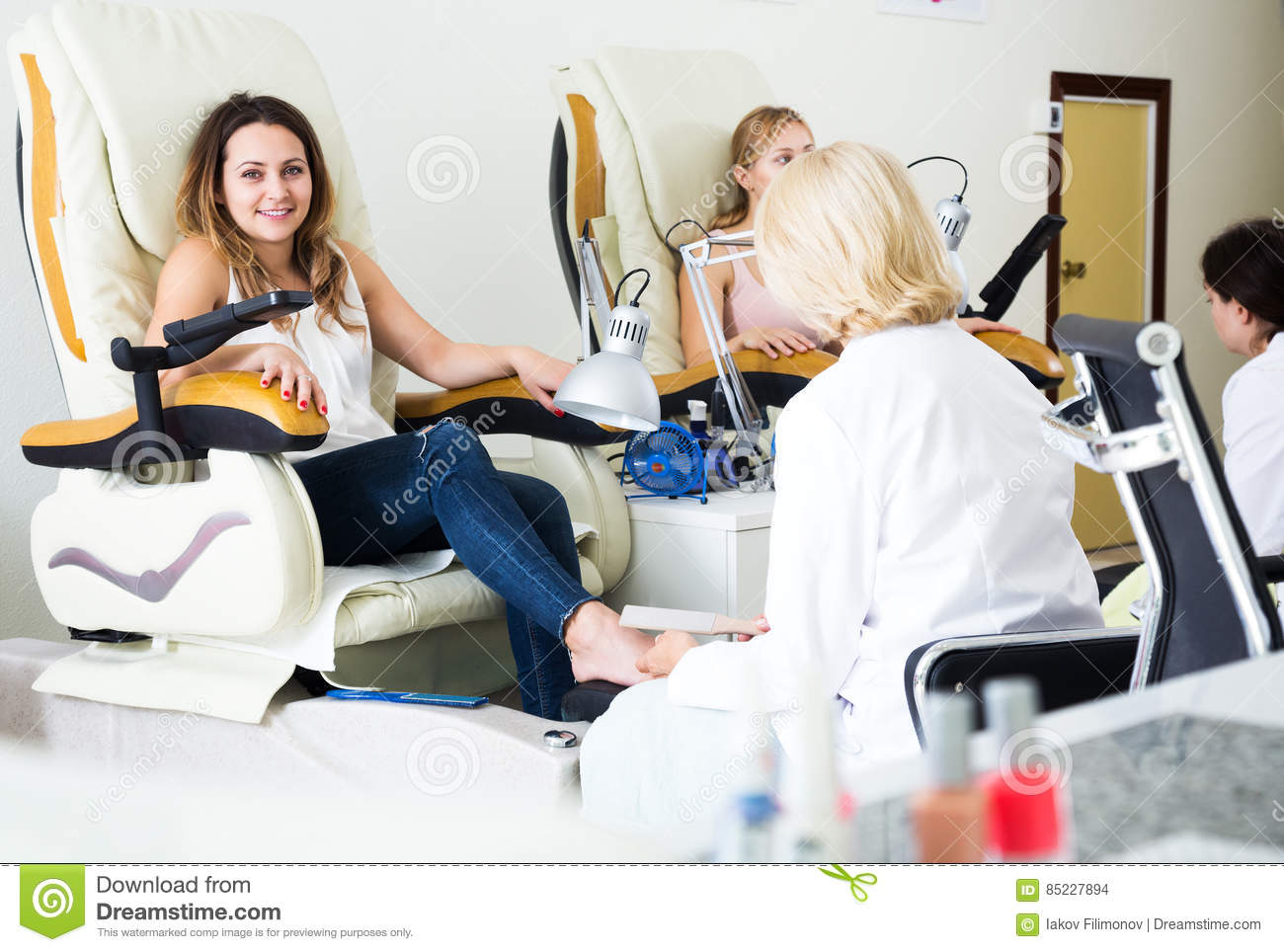 Two clients having pedicure