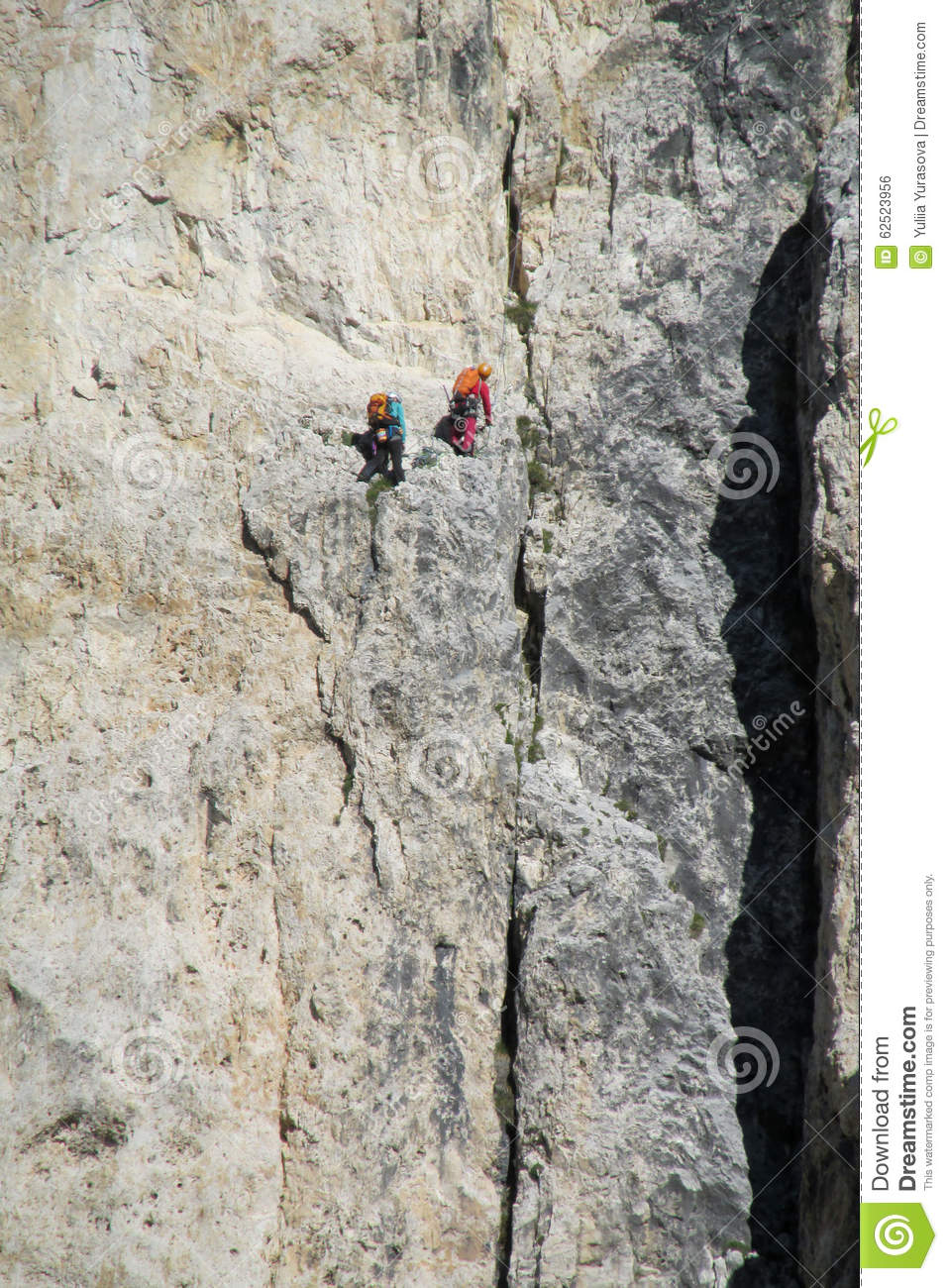 Two climbers on dangerous alpinist route