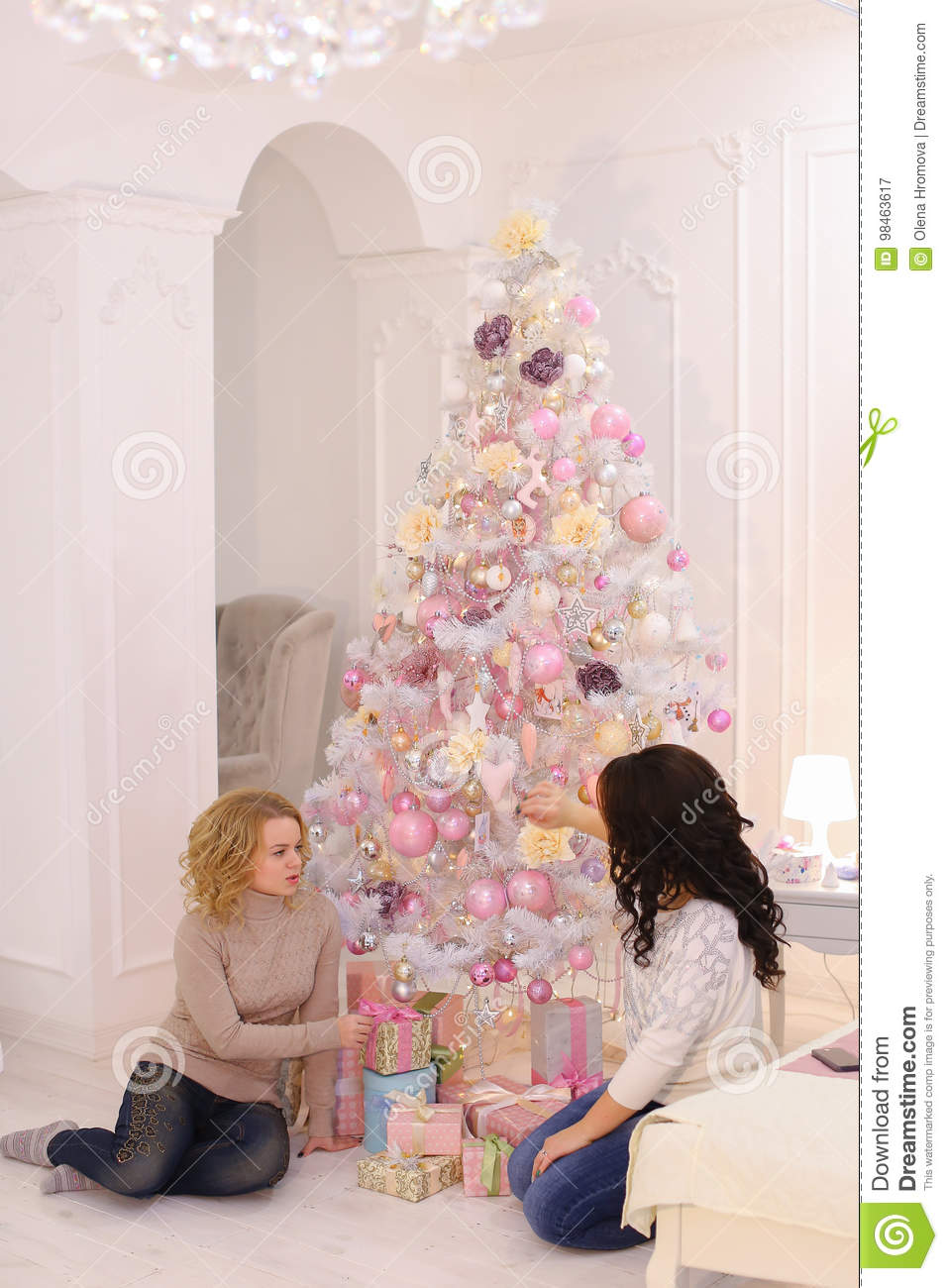 Two close friends share pleasant emotions and festive gifts, sit