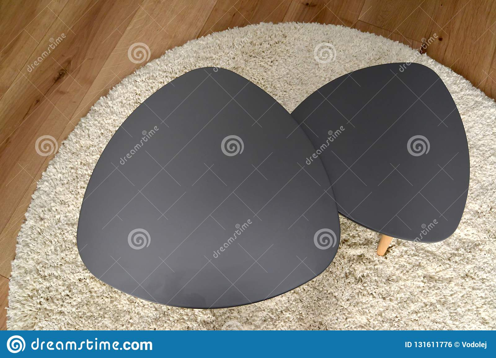 Two Coffee Tables Stand On A Round Rug The Top View Living
