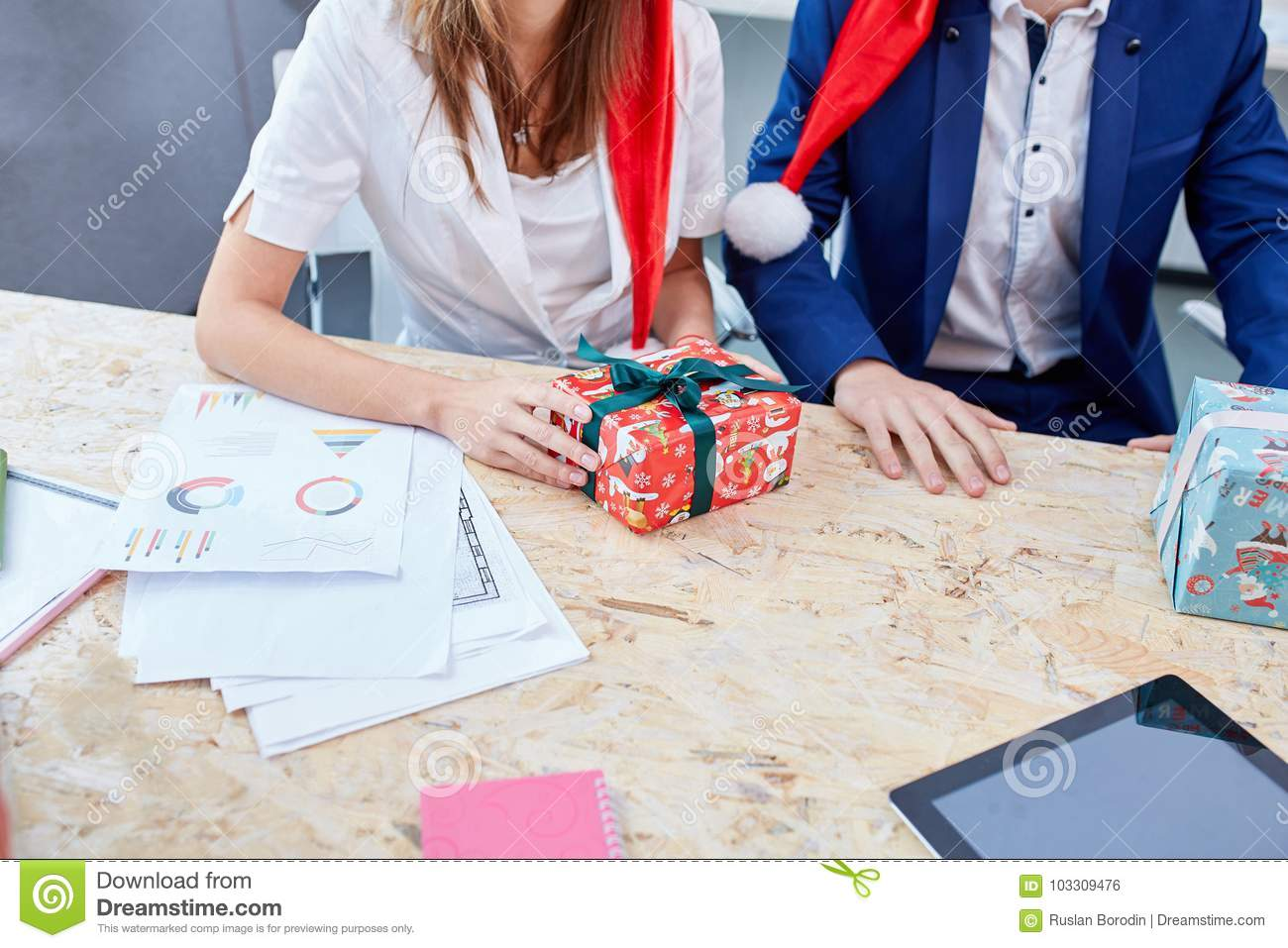 Two Colleagues Exchange Christmas Presents. Inside. Stock Photo ...
