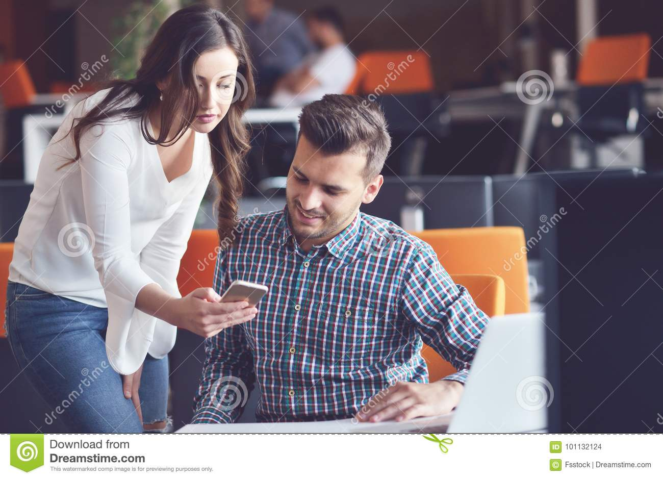 Young Casual business couple using computer in the office. Coworking, Creative manager showing new startup idea