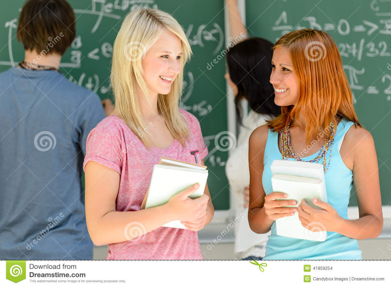 Modern Math Classroom ~ Two college student friends talking math lesson stock