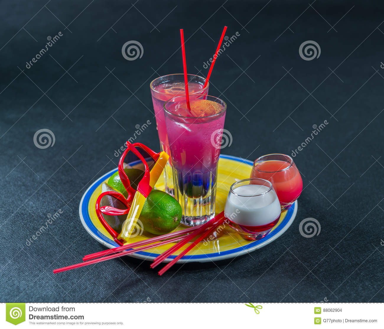 Two colored drinks, a combination of dark blue with purple, the