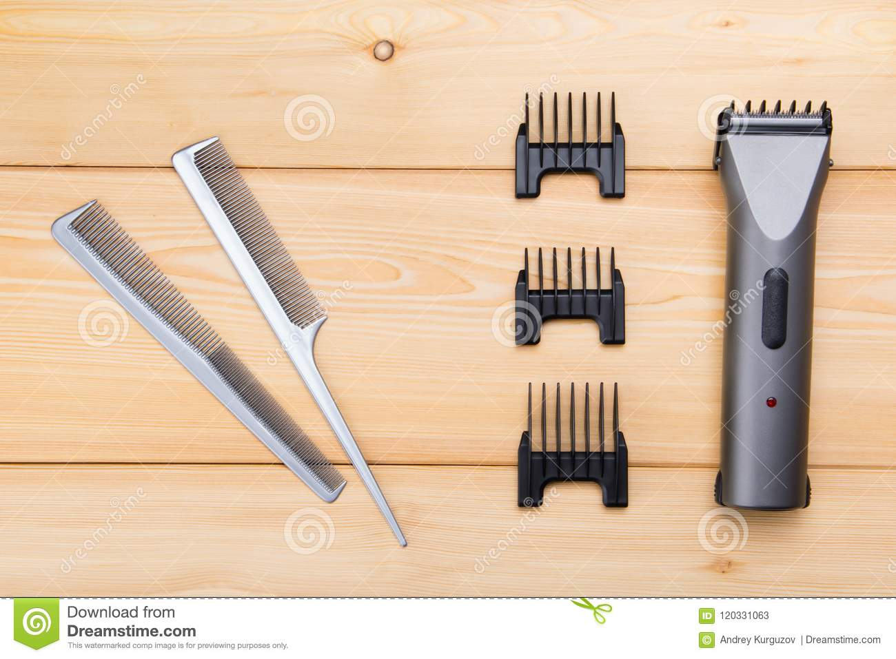Two combs with attachments for electric cars, for hair cutting, on wooden boards