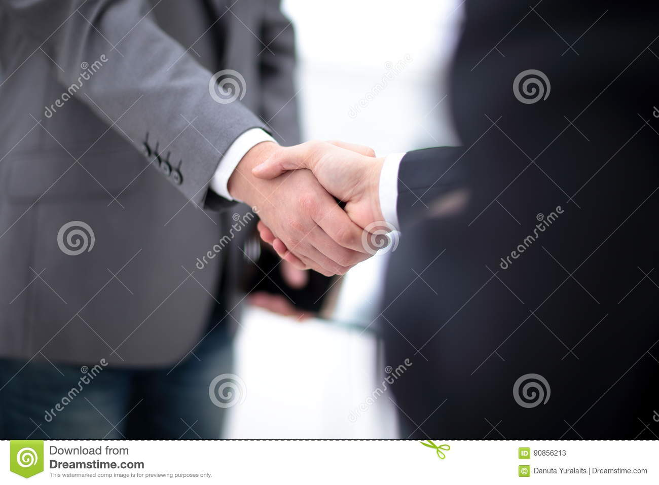 Two Confident Business Man Shaking Hands During A Meeting In Office