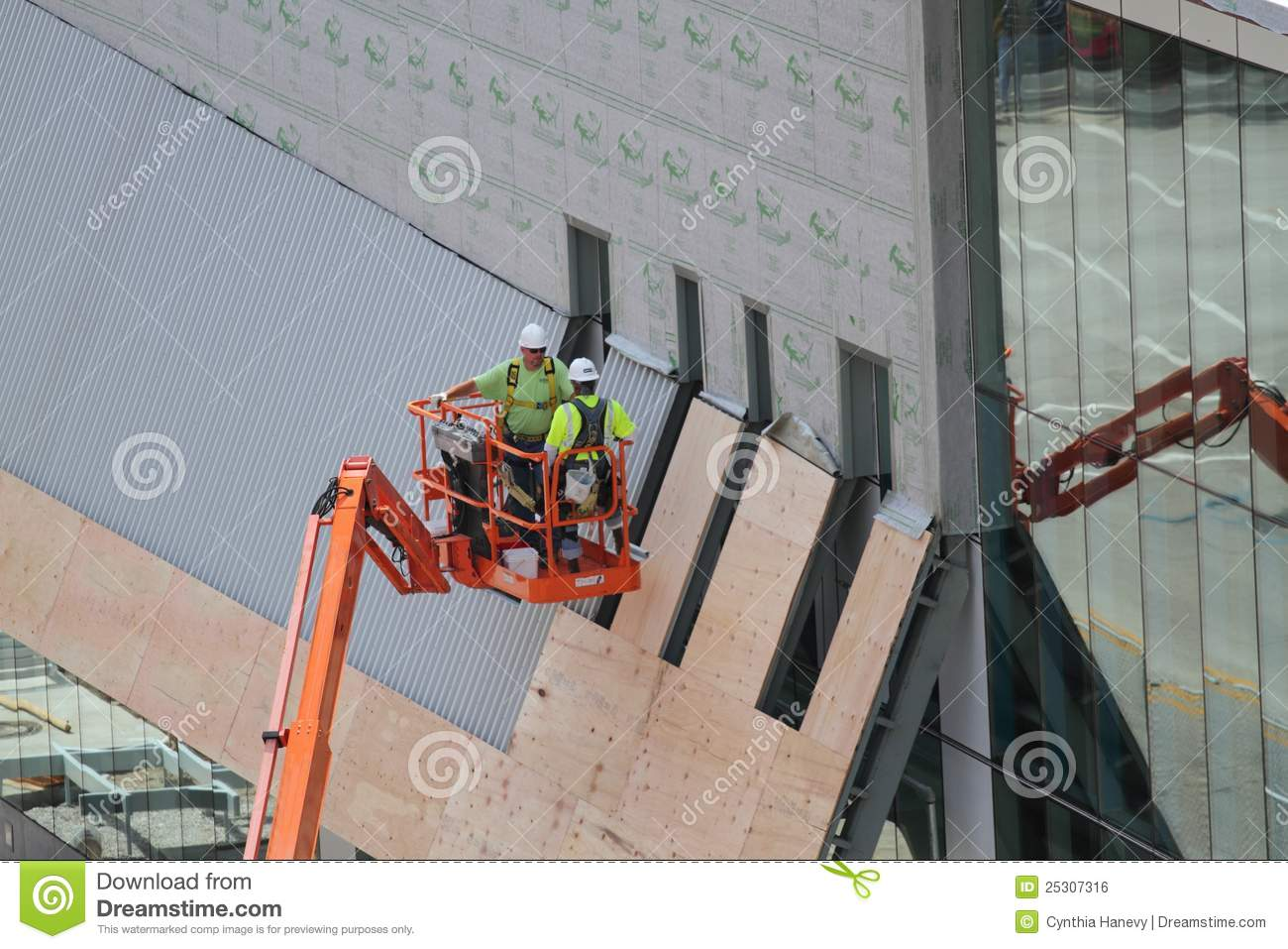 Two Construction Workers On Lift With Safety Vests Editorial Photo