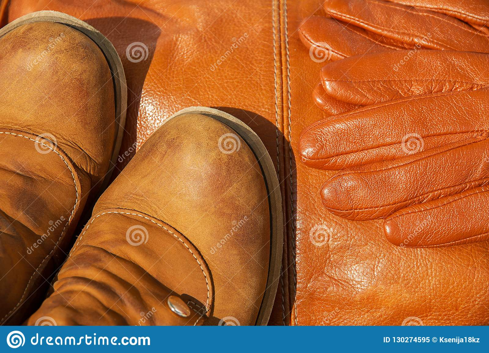 fa2aa3b4f063 Brown Leather Shoes And Gloves On Background Of Same Bag Stock Image ...