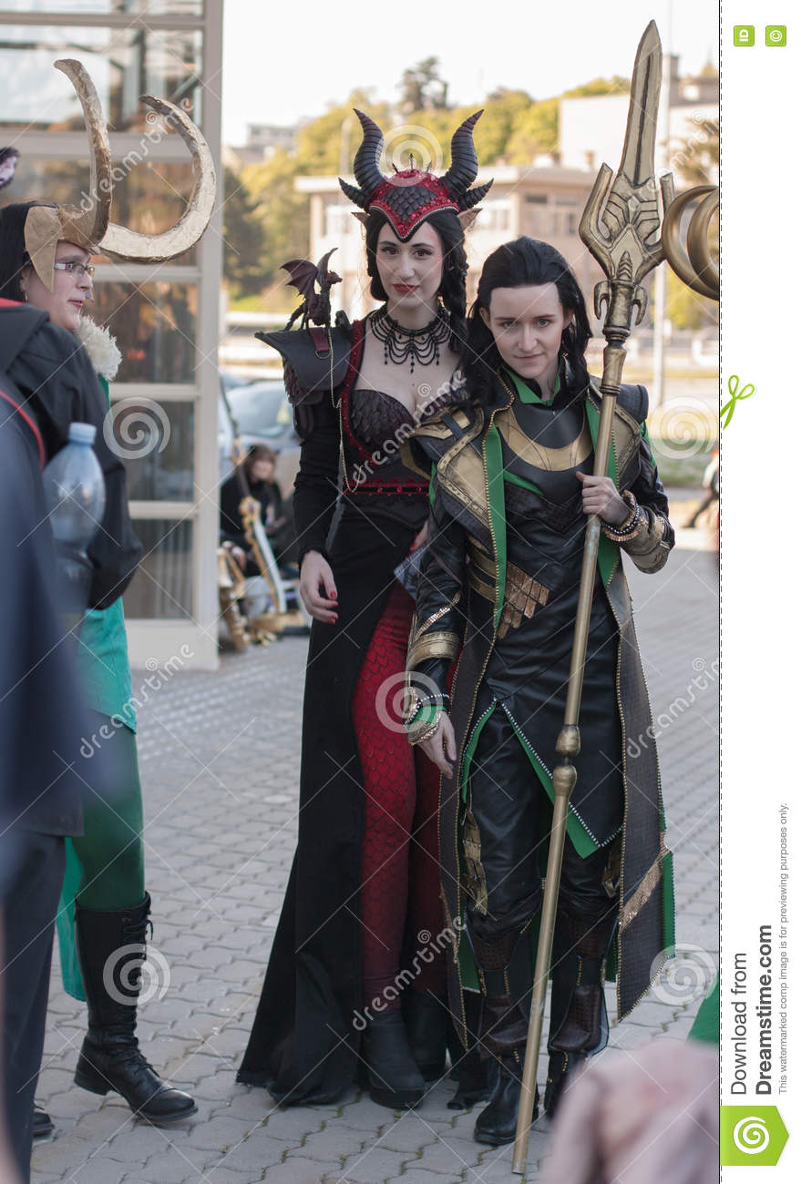two cosplayers dressed as characters ruby dragon and loki editorial