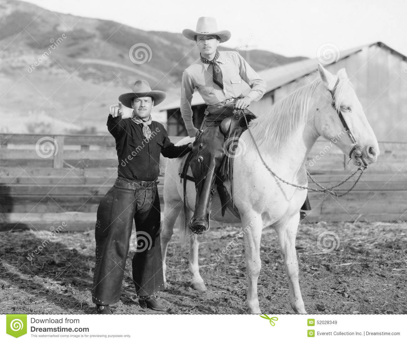 Two cowboys and a white horse