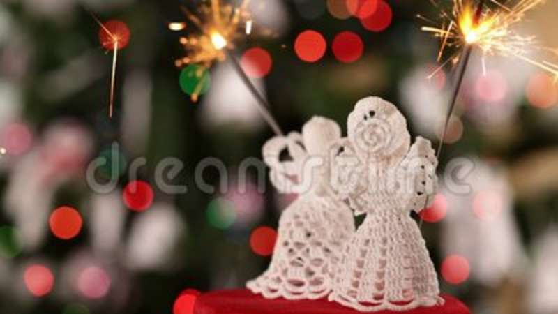 two crocheted christmas angel decorations with sparklers stock footage video of crocheted background 102128496
