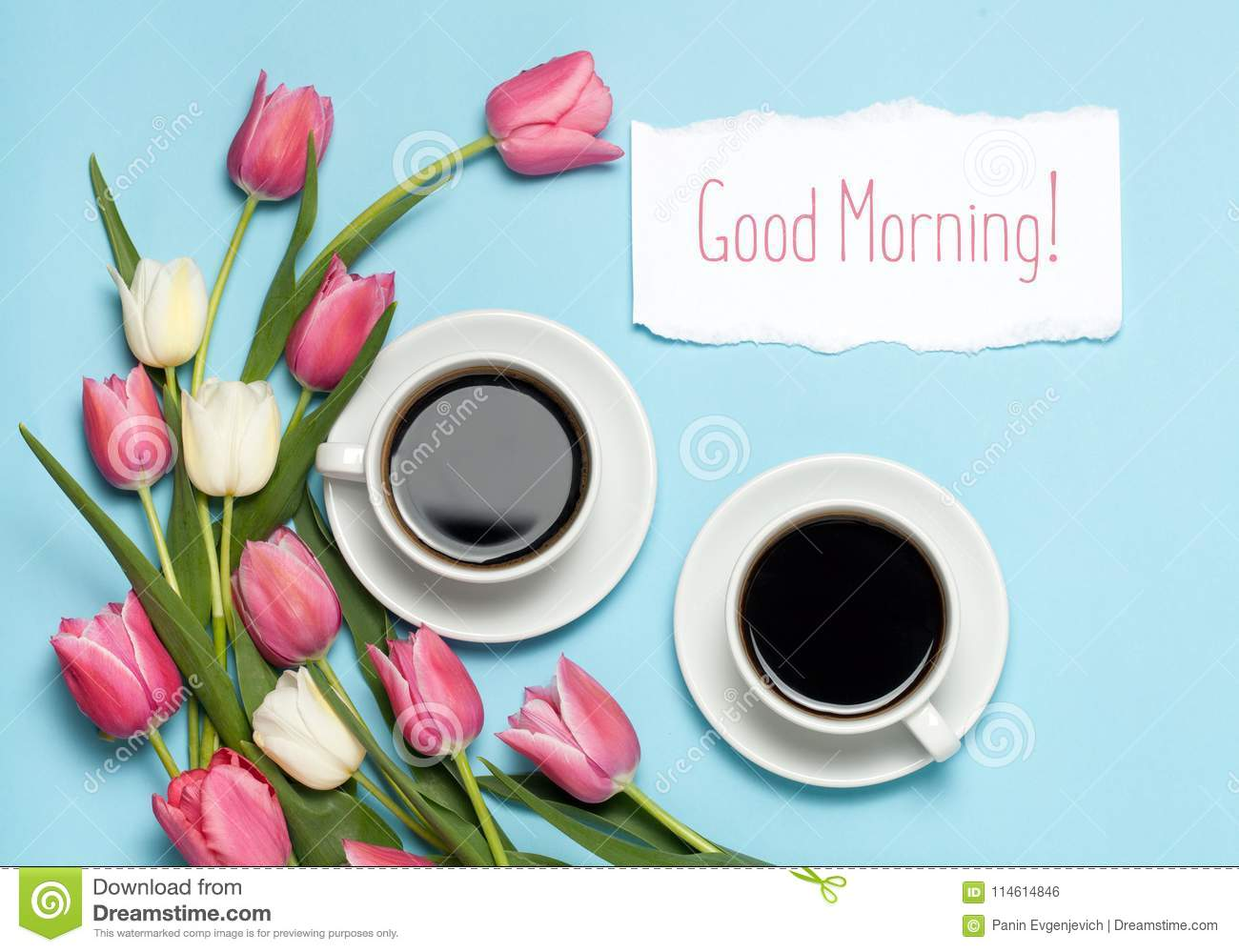Two Cups Of Coffe And Pink Tulips On Blue Background Words Good