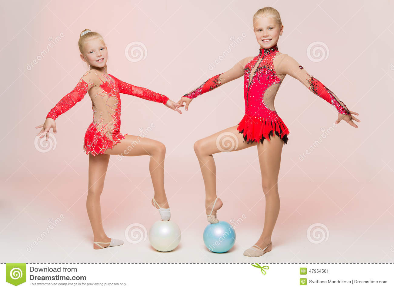 Two cute artistic gymnasts
